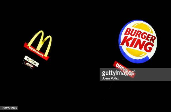 The signs of the fast food companies Burger King and McDonald's are seen side by side on March 5 2009 in Bad Fallingbostel Germany Fast food...