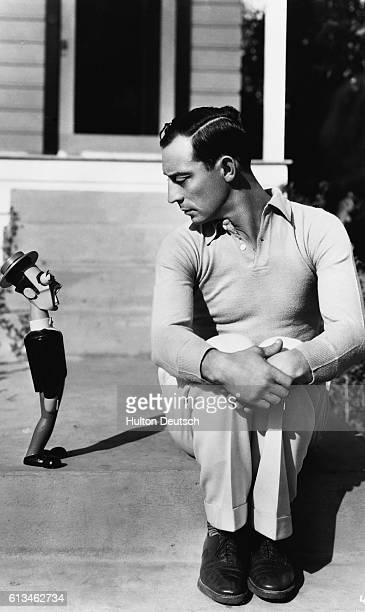 The silentfilm star Buster Keaton with a wooden doll of himself ca 1928