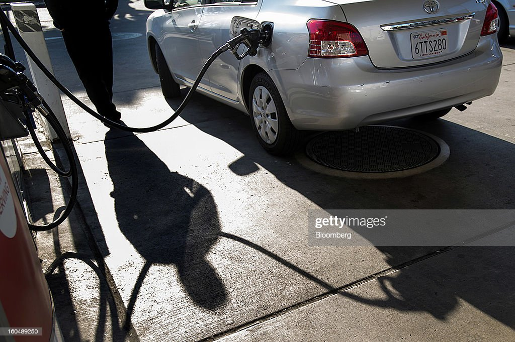 The silhouette of a customer is seen filling a vehicle with gasoline at a Chevron Corp. station in San Francisco, California, U.S., on Friday, Feb. 1, 2013. Chevron Corp., the second-largest U.S. energy company, said fourth-quarter profit increased 41 percent to a record $7.25 billion as it reported stronger refining results and a gain from an Australian natural gas field swap. Photographer: David Paul Morris/Bloomberg via Getty Images