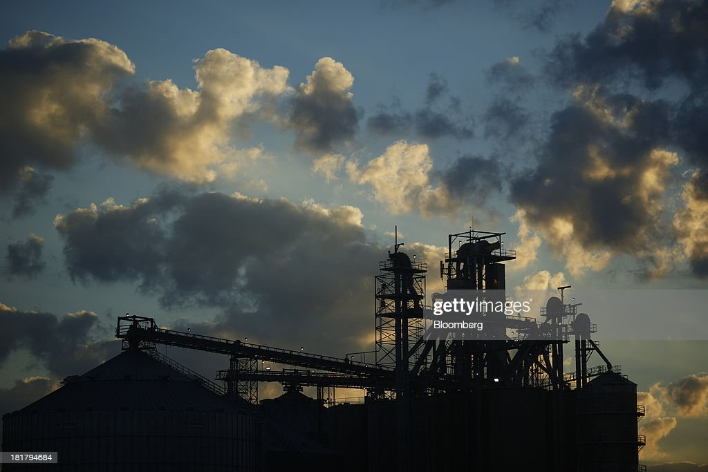 The silhouette of a grain elevator is seen at the Consolidated Grain & Barge Co. facility at sunrise in Jeffersonville, Indiana, U.S., on Tuesday, Sept. 24, 2013. Private exporters reported to the U.S. Department of Agriculture (USDA) export sales of 197,200 metric tons of corn for delivery to Mexico during the 2013 and 2014 marketing year. Photographer: Luke Sharrett/Bloomberg via Getty Images