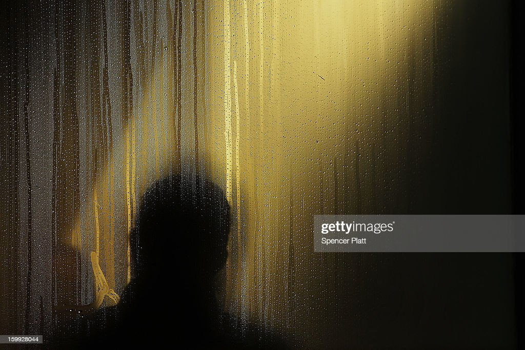 The silhouette of a man is viewed in the steamed window of a Brooklyn coffee shop on one of the coldest days of the year on January 23, 2013 in New York City. Much of the Northeast, will be experiencing colder than usual temperatures for the remainder of the week with temperatures in the 20's and a wind chill feeling in the single digits.
