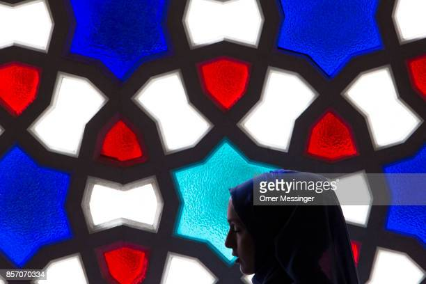 The silhouette of a Muslim woman is seen during midday prayers at Sehitlik mosque which is mostly Turkish on Open Mosque Day on October 3 2017 in...