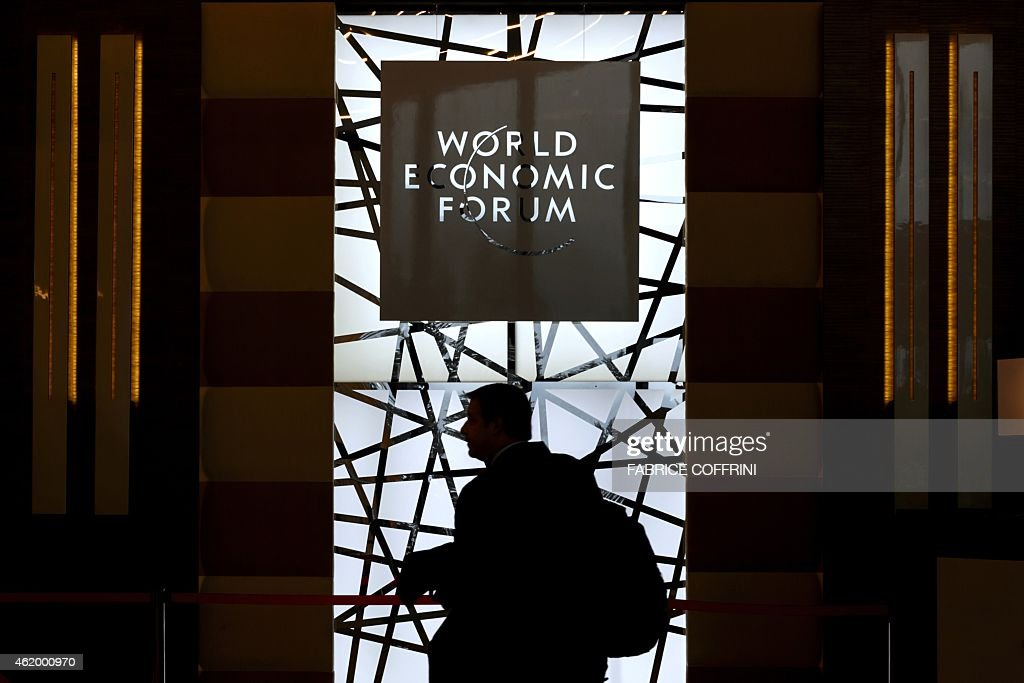 The silhouette of a participant is seen as he enters the Congress Center during the World Economic Forum annual meeting on January 23 2015 in Davos...