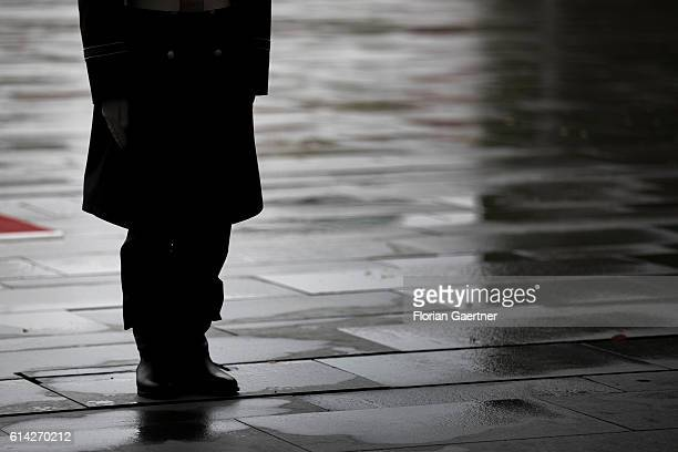 The silhouette of a soldier of the guard batallion is seen in front of the Federal Chancellery on October 12 2016 in Berlin Germany