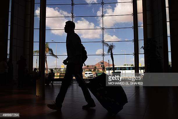 The silhouette of a tourist is seen walking at the airport in Egypt's Red Sea resort of Sharm ElSheikh on November 6 2015 Egypt is not allowing...