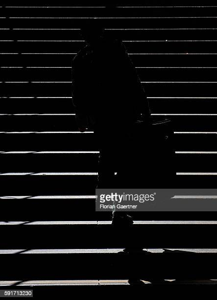 The silhouette of a traveler is captured in front of stairs on April 01 2015 in Frankfurt on the Main Germany
