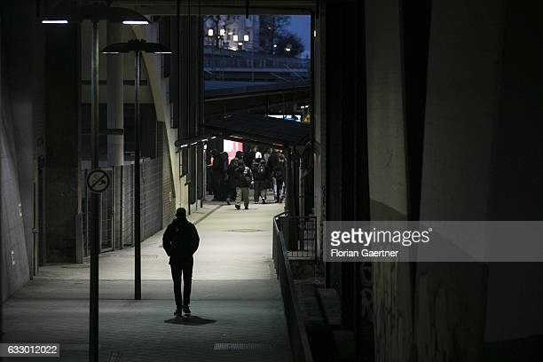 The silhouette of a walking man is captured at a train station on January 27 2017 in Berlin Germany