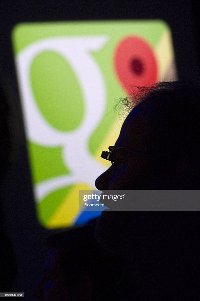 The silhouette of an attendee wearing Google Project Glass is seen at the Google I/O Annual Developers Conference in San Francisco, California, U.S., on Wednesday, May 15, 2013. Google Inc. introduced a subscription music-streaming service, one of several product updates to be unveiled at a developer meeting this week as the search provider seeks to attract more users and advertisers. Photographer: David Paul Morris/Bloomberg via Getty Images