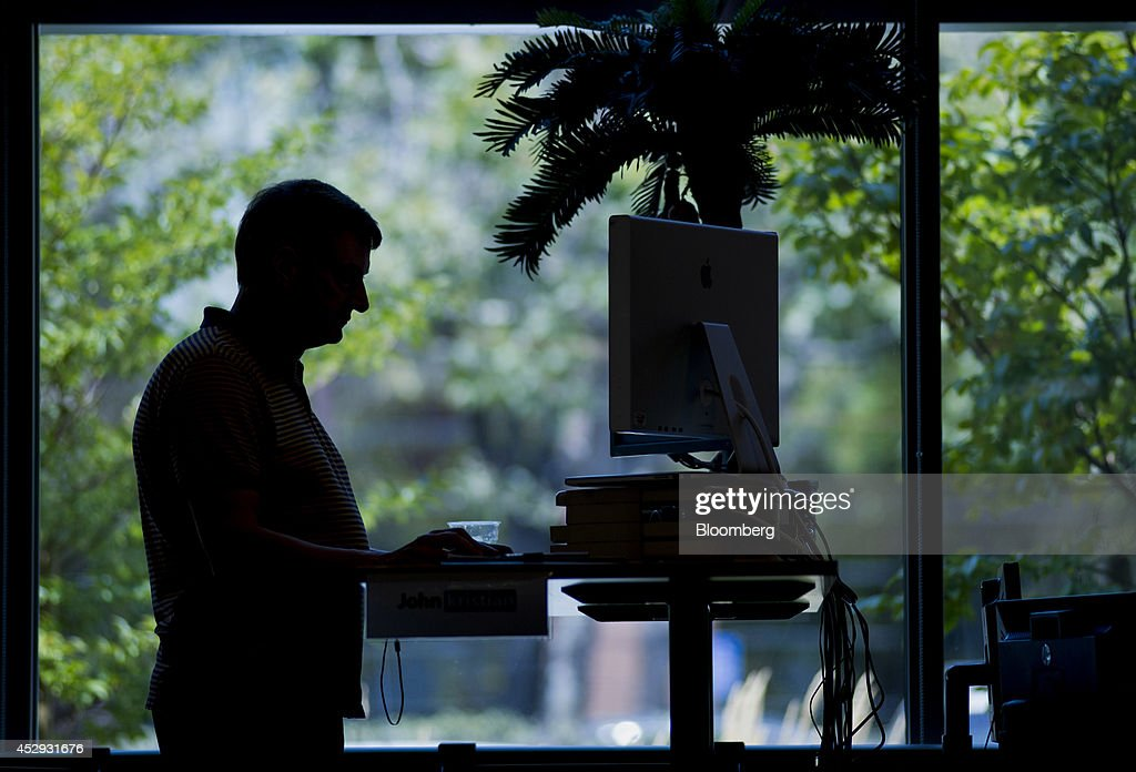 The silhouette of an employee is seen working on his computer at LinkedIn Corp. headquarters in Mountain View, California, U.S., on Monday, July 28, 2014. LinkedIn Corp. is scheduled to release earnings figures on July 31. Photographer: David Paul Morris/Bloomberg via Getty Images