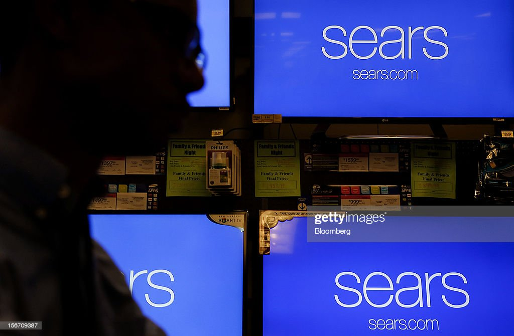 The silhouette of an employee working on a computer is seen at a Sears store during the Family and Friends evening sale inside the Del Amo shopping mall in Torrance, California, U.S., on Sunday, Nov. 11, 2012. Sears Holdings Corp., the retailer controlled by hedge-fund manager Edward Lampert, fell the most in more than 10 months on Nov. 16, after posting a wider third-quarter loss and its 23rd straight quarterly sales decline. Photographer: Patrick Fallon/Bloomberg via Getty Images