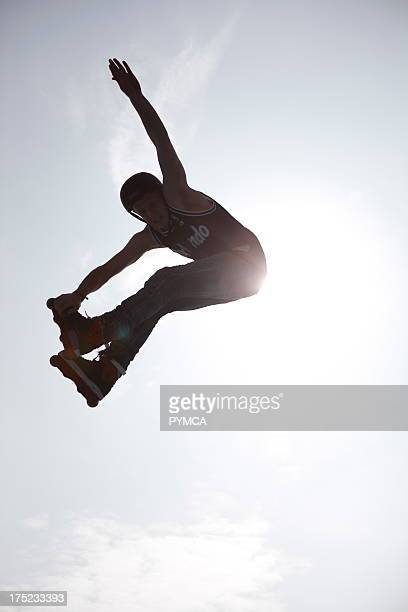 The silhouette of an inline skater flying through the air after jumping off a kicker at the White Air festival Brighton UK