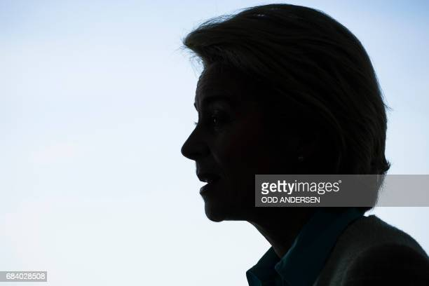The silhouette of German defence minister Ursula von der Leyen is seen as she waits for the opening of the weekly cabinet meeting at the Chancellery...