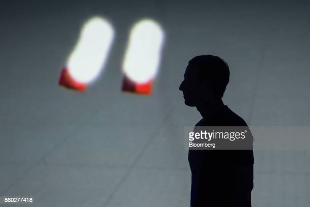 The silhouette of Mark Zuckerberg chief executive officer and founder of Facebook Inc is seen during the Oculus Connect 4 product launch event in San...