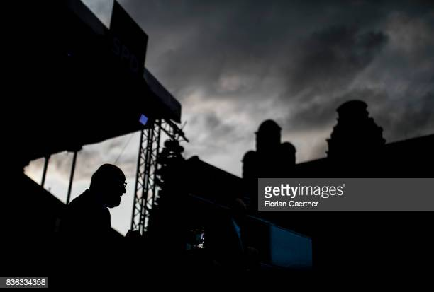 The silhouette of Martin Schulz chancellor candidate of the German Social Democrats is pictured during his speech on the market square on August 21...