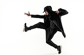 The silhouette of one young hip hop male break dancer dancing on white background