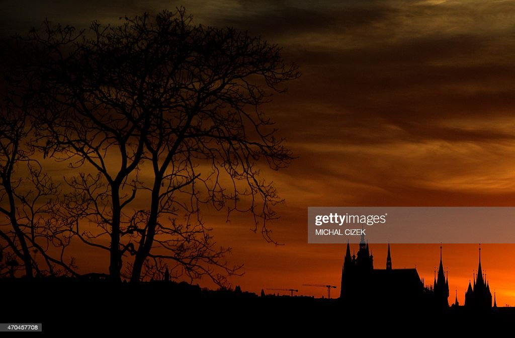 The silhouette of Saint Vitus Cathedral a part of the Prague Castle is seen on April 20 2015 as the sun sets in the Czech capital AFP PHOTO / MICHAL...