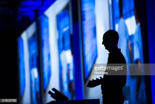The silhouette of Scott Guthrie executive vice president of the cloud and enterprise group at Microsoft Corp is seen as he watches a presentation...