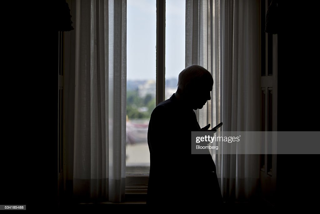 the silhouette of Senator <a gi-track='captionPersonalityLinkClicked' href=/galleries/search?phrase=John+McCain&family=editorial&specificpeople=125177 ng-click='$event.stopPropagation()'>John McCain</a>, a Republican from Arizona and chairman of the Senate Armed Services Committee, is seen talking on a mobile phone in a hallway of the U.S. Capitol in Washington, D.C., U.S., on Wednesday, May 25, 2016. Women would be required to register for the military draft, and the White Houses National Security Council staff would be reduced significantly under the fiscal 2017 defense authorization measure approved this month by the Senate Armed Services Committee. Photographer: Andrew Harrer/Bloomberg via Getty Images