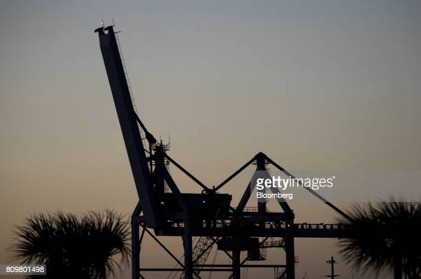 The silhouette of shipping cranes are seen during the night at Port Canaveral in Cape Canaveral Florida US on Wednesday July 5 2017 The US Census...