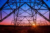 The silhouette of the evening electricity transmission pylon