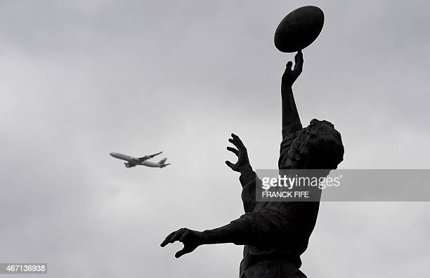 The silhouette of the iconic bronze statue of rugby lineout by British sculptor Gerald Laing is pictured before the Six Nations international rugby...