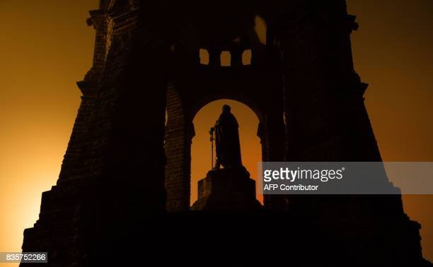 The silhouette of the KaiserWilhelm monument in Porta Westfalica western Germany is pictured on August 20 2017 / AFP PHOTO / dpa / Lino Mirgeler /...