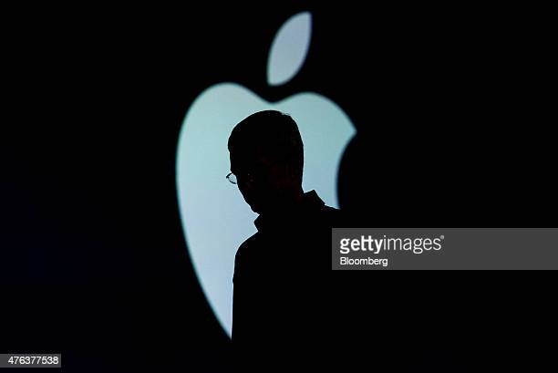 The silhouette of Tim Cook chief executive officer of Apple Inc is seen as he exits the stage during the Apple World Wide Developers Conference in...