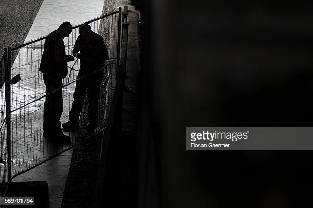 The silhouette of two working men are captured on August 04 2016 in Berlin Germany