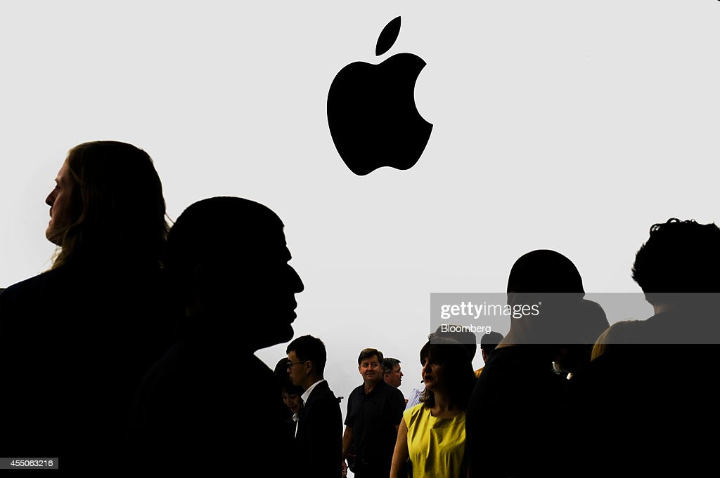 The silhouettes of attendees are seen after a product announcement at Flint Center in Cupertino California US on Tuesday Sept 9 2014 Apple Inc...
