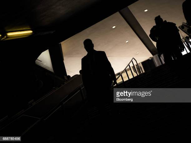 The silhouettes of commuters are seen walking down the stairs inside Pennsylvania Station in New York US on Friday May 26 2017 PresidentDonald...