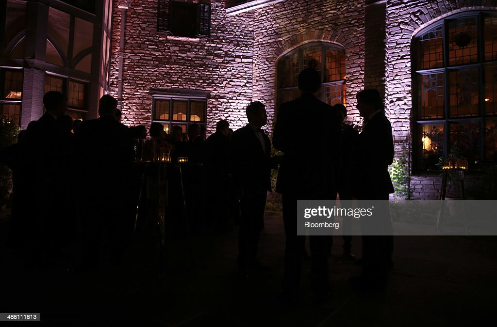 The silhouettes of guests are seen at the Bloomberg Vanity Fair White House Correspondents' Association (WHCA) dinner afterparty in Washington, D.C., U.S., on Saturday, May 3, 2014. The WHCA, celebrating its 100th anniversary, raises money for scholarships and honors the recipients of the organization's journalism awards. Photographer: Andrew Harrer/Bloomberg via Getty Images