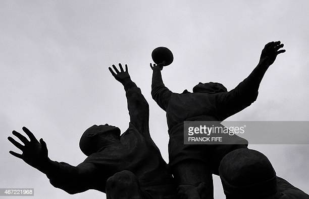 The silhouettes of the iconic bronze statue of rugby lineout by British sculptor Gerald Laing is pictured before the Six Nations international rugby...