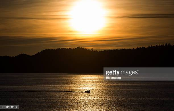 The silhoutte of a fishing boat is seen at sunset near the Port of Prince Rupert in Prince Rupert British Columbia Canada on Tuesday Aug 23 2016...