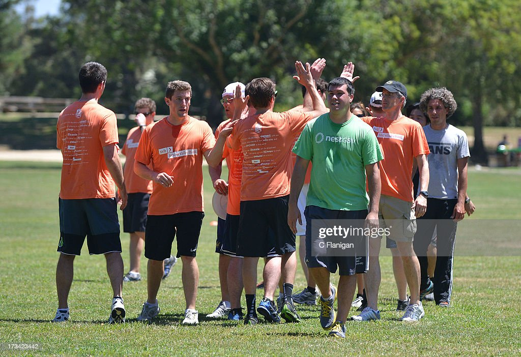 The Silicon Valley Banks teams celebrate victory in the Ultimate Frisbee during the Founder Institute's Silicon Valley Sports League event on July 13, 2013 in Palo Alto, California.