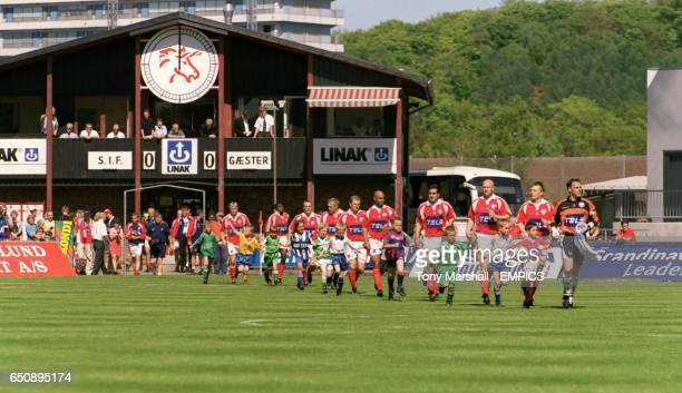 The Silkeborg team emerge from their wooden dressing room