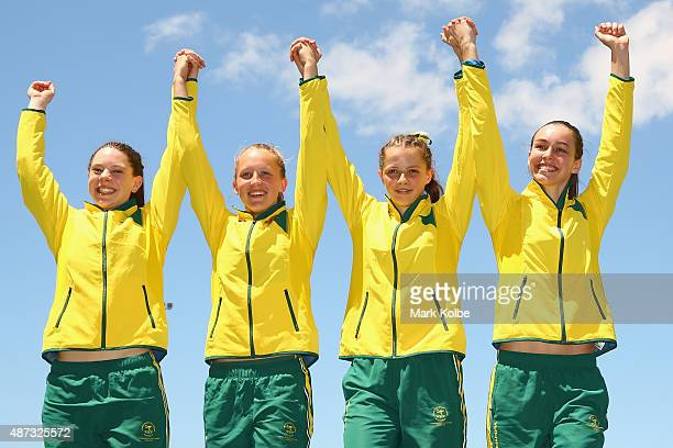 The silver medal winning Australia girls 4 x 100m relay team celebrate during the medal ceremony during the athletics competition at the Apia Park...