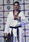 The silver medalist Nur Tatar of Turkey poses after winning the women's 67 kg final match of WTF World Taekwondo Championships 2015 at the Traktor...