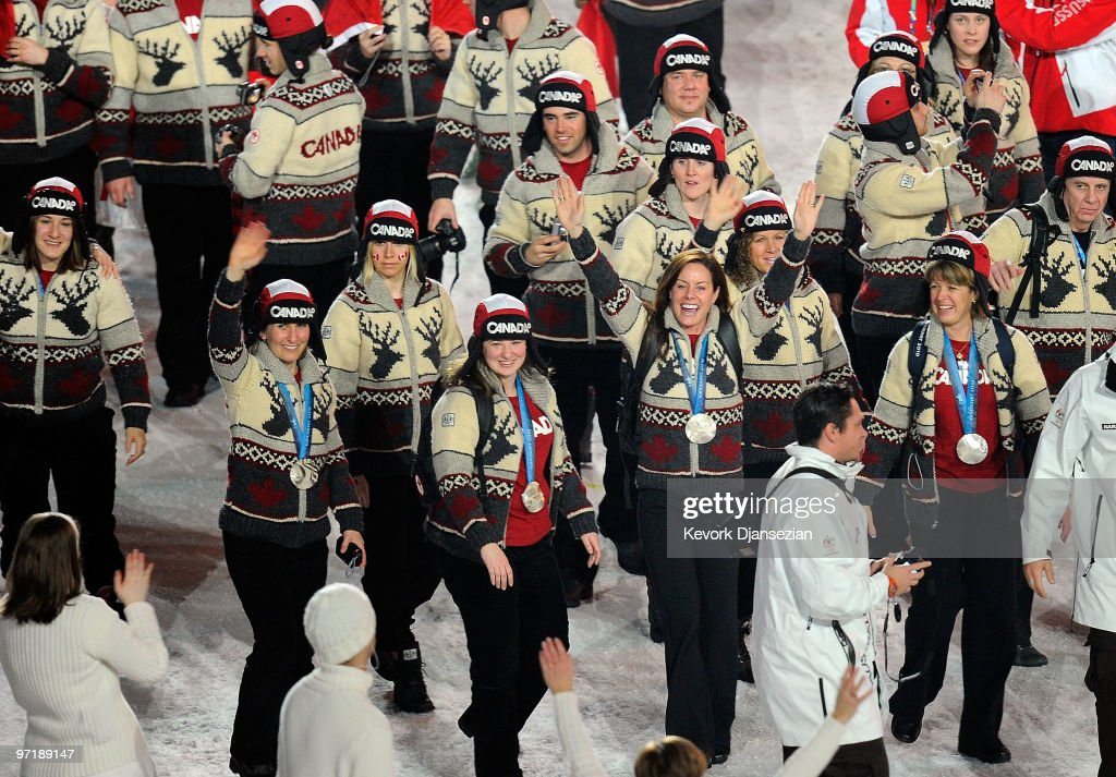 The silver medal-winning Canadian women's curling team walk with the Canadian Team during the Closing Ceremony of the Vancouver 2010 Winter Olympics at BC Place on February 28, 2010 in Vancouver, Canada.