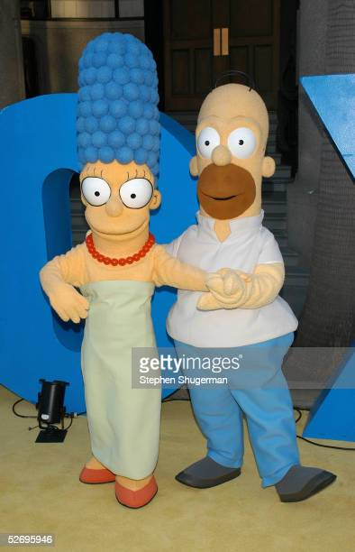 The Simpsons characters Homer and Marge attend 'The Simpsons' 350th episode block party on the New York street of Fox Pico Lot on April 25 2005 in...