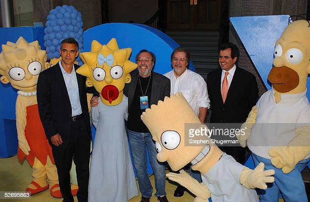 'The Simpsons' charactors pose with Peter Ligouri President of Entertainment FBC James L Brooks Executive Producer Matt Groening Creator and...
