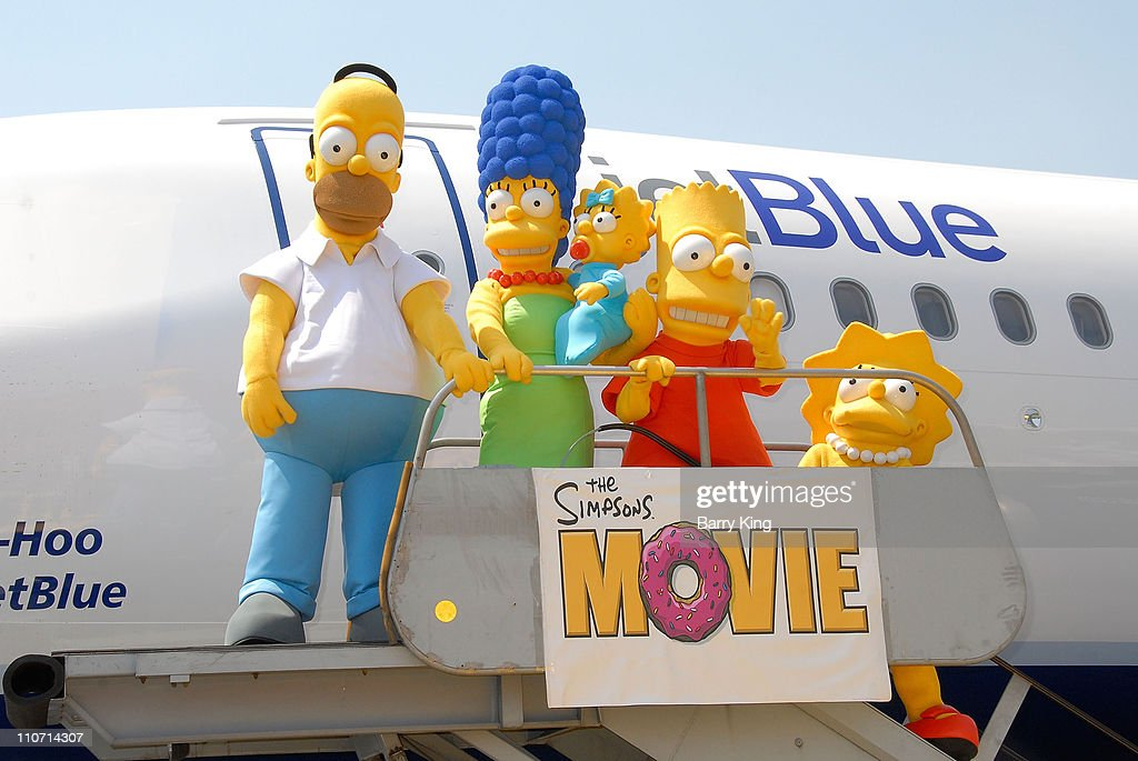 The Simpsons family members Homer Marge Maggie Bart and Lisa Simpson at the JetBlue Airways Unveiling of 'Simpsons' aircraft to celebrate upcoming...