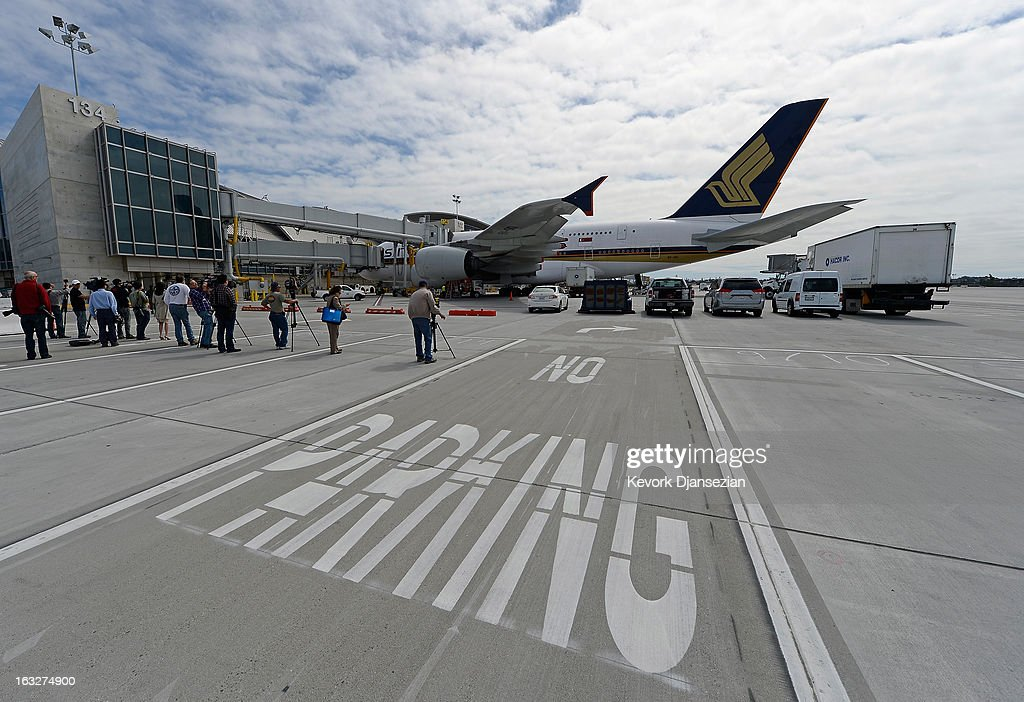 The Singapore Airlines daily flight SQ 12 from Singapore arrives to dock at Gate 134 during the unveiling of the north concourse and three gates of the new Tom Bradley International Terminal at Los Angeles International Airport on March 6, 2013 in Los Angeles, California. Nine of the new 18 gates, including two of the three unveiled, can accomodate large aircrafts such as the Boeing 747-8 Intercontinental and Airbus A-380 superjumbo jet. LAX is currently undergoing a $4.1 billion airport modernization program.