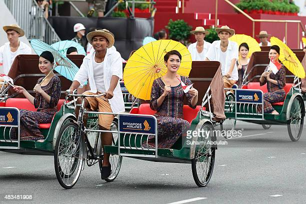 The Singapore Airlines vintage contingent march past during the National Day Parade at Padang on August 9 2015 in Singapore Singapore is celebrating...