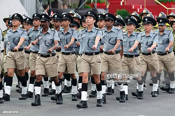 The Singapore Police Force vintage contingent march past during the National Day Parade at Padang on August 9 2015 in Singapore Singapore is...
