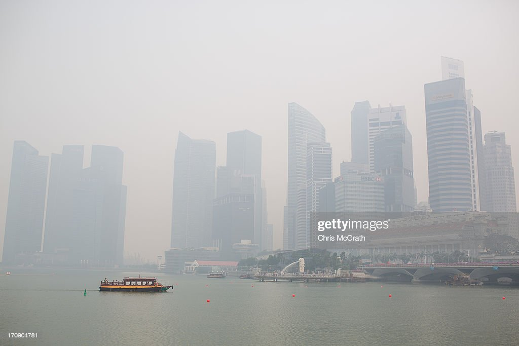 The Singapore skyline is seen covered in smoke haze on June 20, 2013 in Singapore. The Pollutant Standards Index (PSI) rose to the highest level on record reaching 371 at 1pm. The haze is created by deliberate slash-and-burn forest fires started by companies in neighbouring Sumatra.