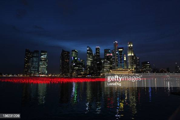 The Singapore skyline is seen with wishing spheres in the waters of the bay as Singapore prepares for New Year's Eve at Marina Bay on December 29...