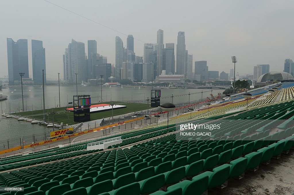 The Singapore waterfront stadium and Formula One racetrack seen in the foreground and the Marina Bay skyline is blanketed by haze on September 18...