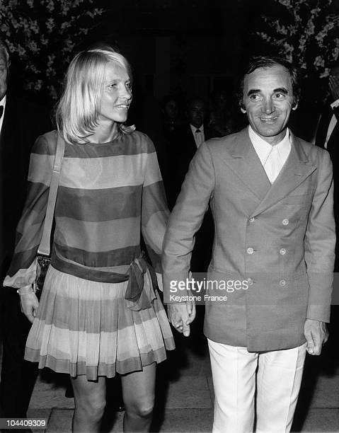 The singer Charles AZNAVOUR and his wife at the Red Croos gala in MonteCarlo during the party This gala was presided over by Princess GRACE and...