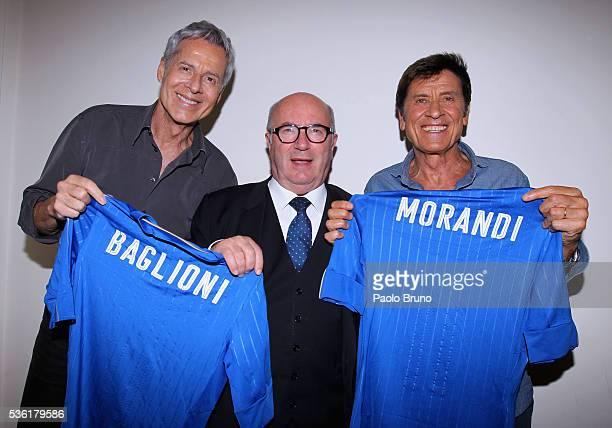 The singer Claudio Baglioni FIGC President Carlo Tavecchio and Gianni Morandi pose with Italian jersey before the 'Sogno Azzurro' TV programme at...