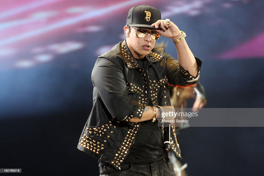 The singer Daddy Yankee of Puerto Rico dances on stage at the Quinta Vergara during the 53rd Vina del Mar International Music Festival on February 25, 2013 in Vina del Mar, Chile.